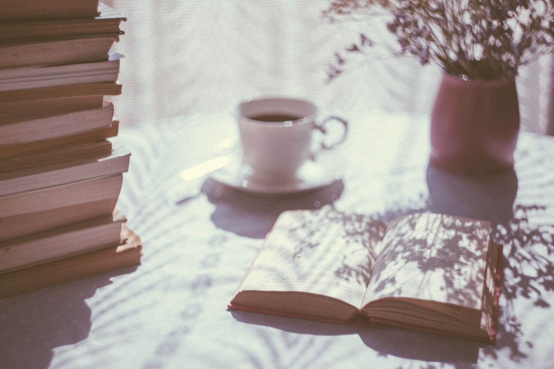 A table with books and hot tea